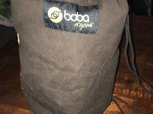 Pochette de rangement et poches dans la ceinture du porte bébé